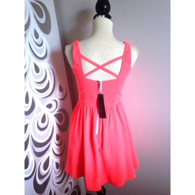 C. Luce short dress Coral Highlighter Bright Orange V-neck Open Back Backless Skater Skater Sun Cute on Tradesy