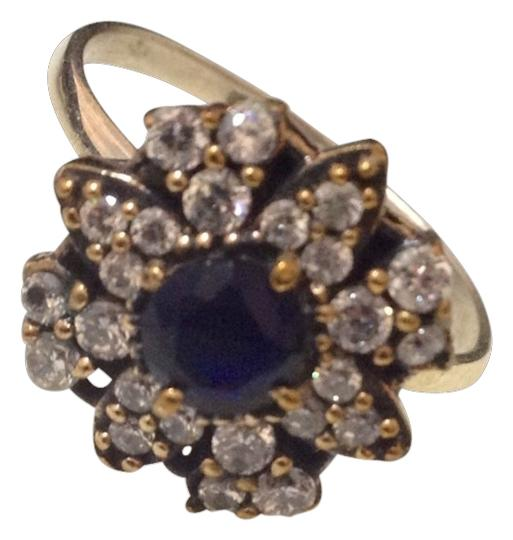 Preload https://item2.tradesy.com/images/silver-and-blue-flower-size-75-ring-1476381-0-0.jpg?width=440&height=440