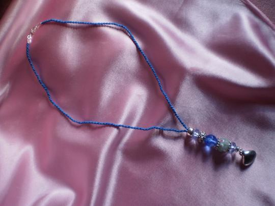 Other Like new Bead necklace on Blue cord