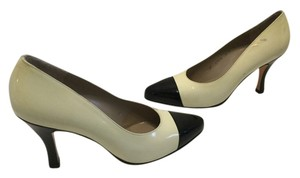 Salvatore Ferragamo All Leather Capped Toes Italian Black and cream patent Pumps