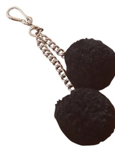 Coach COACH SHEARLING pom pom bag charm In Black color New!!