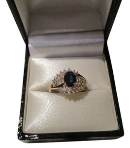 18Kt Yellow Gold Oval Sapphire & Diamond Ring