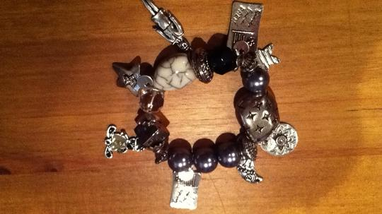 Romy Charm kisses from Paris stretchy silver bead bracelet stars and postcards