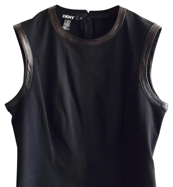 Preload https://img-static.tradesy.com/item/14846998/dkny-black-leather-shell-night-out-top-size-10-m-0-1-650-650.jpg