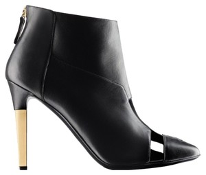 Chanel Black Gold Tone Heel 4
