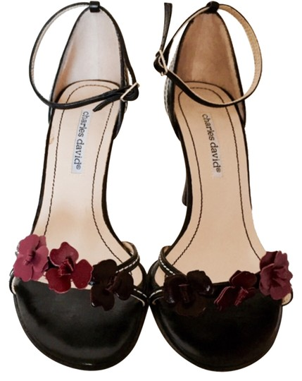 Preload https://item4.tradesy.com/images/charles-david-black-with-lavender-and-purple-flowers-pumps-size-us-8-regular-m-b-14854273-0-1.jpg?width=440&height=440