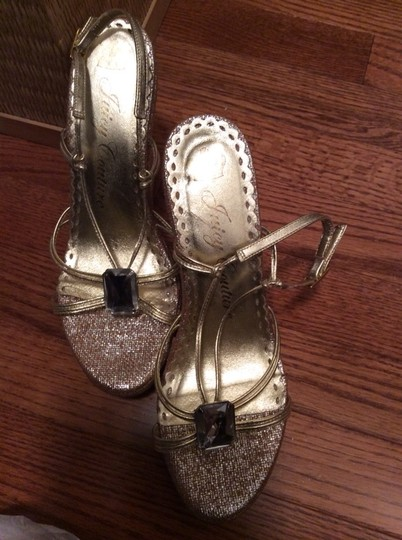 Juicy Couture Gold Platforms