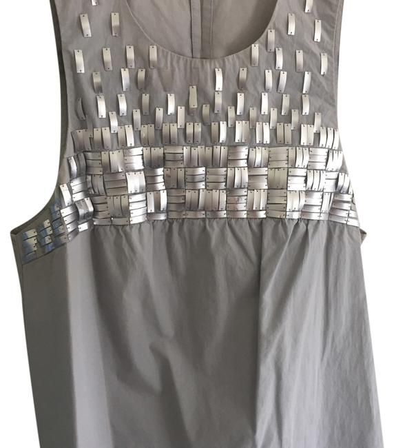 Preload https://item1.tradesy.com/images/vince-silver-night-out-top-size-4-s-14857165-0-1.jpg?width=400&height=650