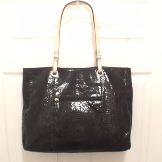 Preload https://item4.tradesy.com/images/wilsons-leather-python-snake-print-black-white-suede-tote-14859133-0-0.jpg?width=440&height=440