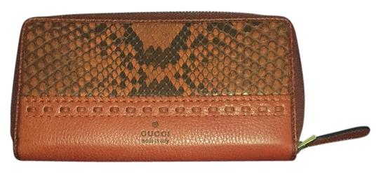 Preload https://img-static.tradesy.com/item/14859829/gucci-python-deep-orange-and-black-leather-clutch-0-1-540-540.jpg