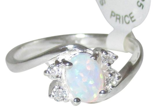 Preload https://item2.tradesy.com/images/j-brand-white-opal-925-sterling-silver-shaped-real-size-5-6-7-8-9-ring-14862931-0-1.jpg?width=440&height=440