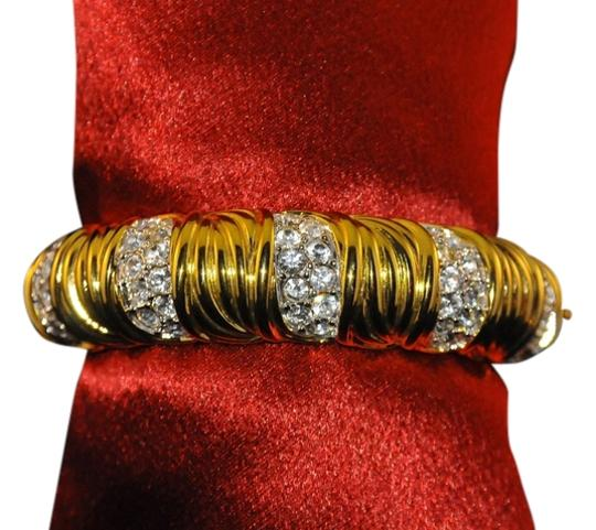 Preload https://item4.tradesy.com/images/nolan-miller-gold-and-clear-crystal-glamour-collection-18k-plated-bangle-w-new-bracelet-14863408-0-1.jpg?width=440&height=440