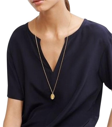 Preload https://item1.tradesy.com/images/tory-burch-gold-mikah-pendant-long-necklace-14865610-0-3.jpg?width=440&height=440