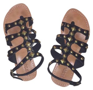 Mystique Boutique black and gold Sandals