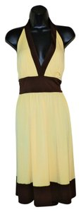 Maggy London short dress Yellow & Brown Halter Stretchy Belted on Tradesy