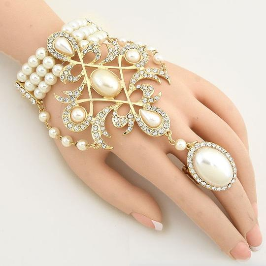 Preload https://item3.tradesy.com/images/cream-gold-tone-clear-crystal-pearl-majestic-motif-hand-chain-rhinestone-accent-handchain-bracelet-14887192-0-0.jpg?width=440&height=440