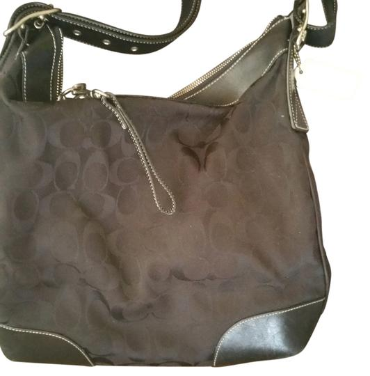 Preload https://item5.tradesy.com/images/coach-black-fabric-with-leather-accents-shoulder-bag-14891494-0-1.jpg?width=440&height=440