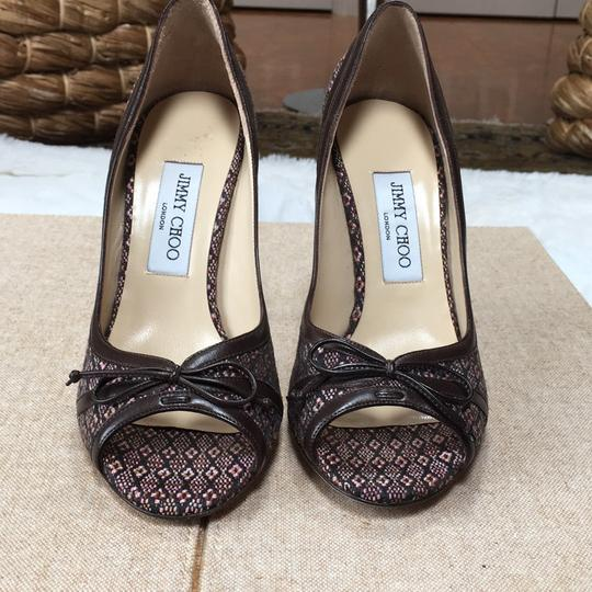Jimmy Choo Soft blends of very light pink and brown. Formal