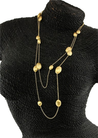 Preload https://item4.tradesy.com/images/marco-bicego-18-k-gold-siviglia-46-single-strand-nugget-stations-necklace-14899498-0-1.jpg?width=440&height=440
