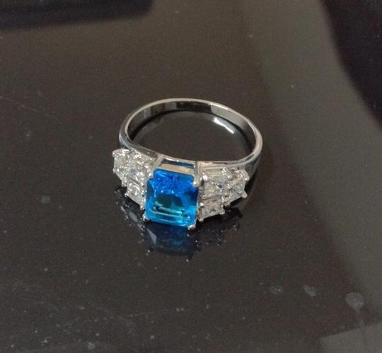 Preload https://img-static.tradesy.com/item/1489968/blue-and-silver-natural-gem-engagement-size-9-ring-0-0-540-540.jpg