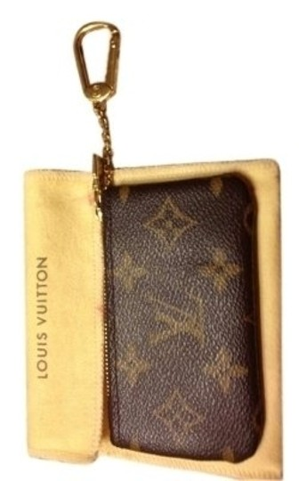 Preload https://item1.tradesy.com/images/louis-vuitton-brown-monogram-leather-wristlet-149035-0-0.jpg?width=440&height=440