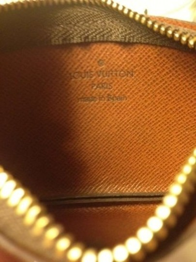Louis Vuitton Wristlet in Brown Monogram