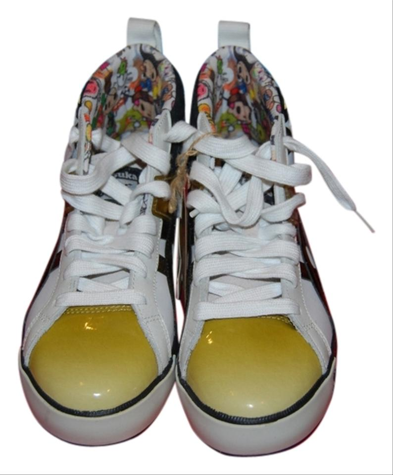huge discount bb1e0 79e8d Gold Black and White Sneakers