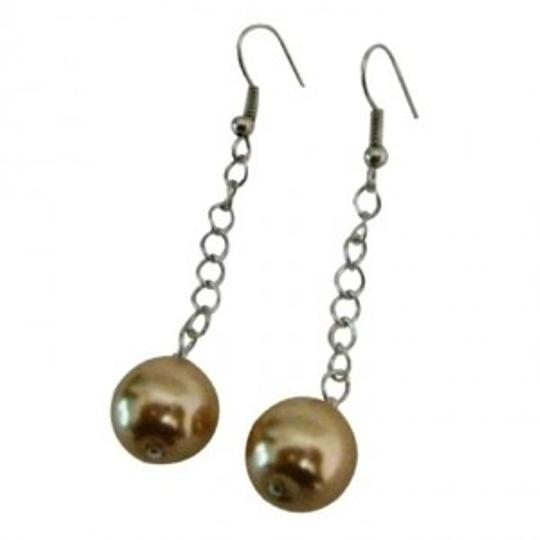 Preload https://item4.tradesy.com/images/brown-single-pearls-champagne-color-dangling-earrings-149158-0-0.jpg?width=440&height=440