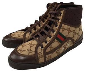 Gucci Gucci logo fabic in different tones of brown. Athletic