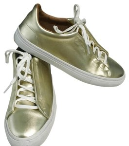 Zara shiny plimsolls Gold Athletic