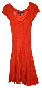 BCBGMAXAZRIA short dress Red Bcbg Max Azria Sweater on Tradesy