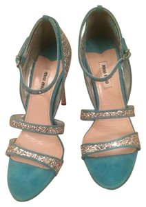 Brand-new never worn miu miu shoes Silver confetti glitter with suede turquoise blue with a strap at the ankle comes with the box if you have any questions just ask Silver and turquoise blue Pumps