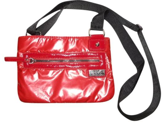 Preload https://img-static.tradesy.com/item/1495064/kenneth-cole-reaction-red-polyester-and-poly-vinyl-cross-body-bag-0-0-540-540.jpg