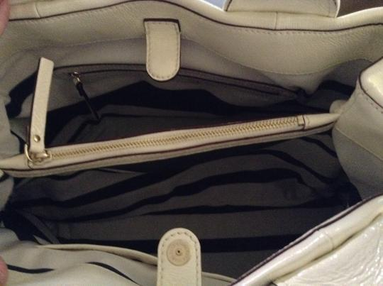 Kate Spade Patent Leather Dual Internal Compartment With Middle Zip Pocket Two Small Open Pockets For Cell Phone Zippered Pocket Satchel in Eggshell