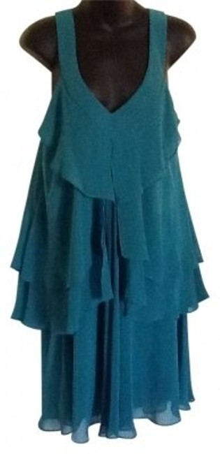 Preload https://item2.tradesy.com/images/mm-couture-green-backless-above-knee-night-out-dress-size-12-l-149851-0-0.jpg?width=400&height=650