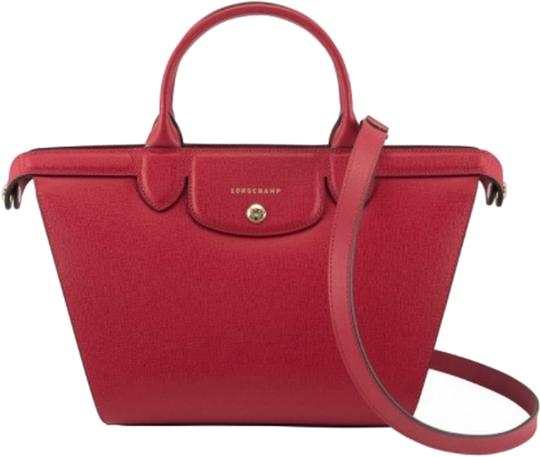 Preload https://item1.tradesy.com/images/longchamp-le-pliage-heritage-smallmedium-handbag-carmine-red-leather-satchel-14987500-0-1.jpg?width=440&height=440