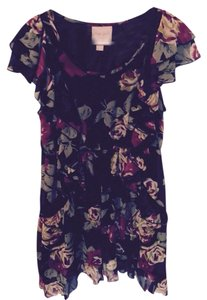 Romeo & Juliet Couture short dress Black floral with ruffles on Tradesy