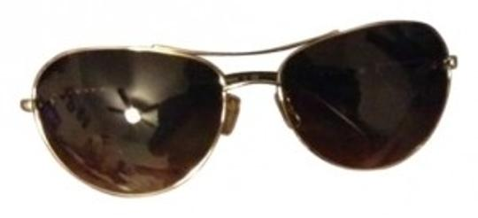 Preload https://item2.tradesy.com/images/coach-browngold-sunglasses-149971-0-0.jpg?width=440&height=440