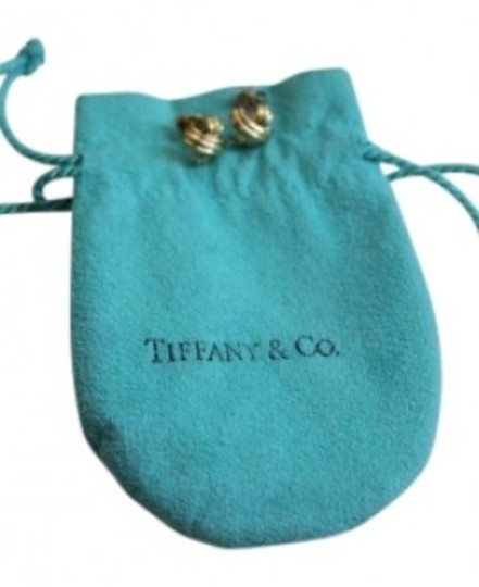 Preload https://item2.tradesy.com/images/tiffany-and-co-gold-18k-signature-retired-x-kiss-pierced-earrings-150141-0-0.jpg?width=440&height=440