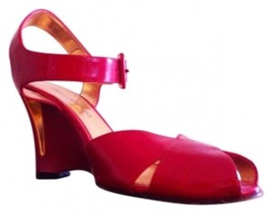 Preload https://item4.tradesy.com/images/enzo-angiolini-red-patent-leather-sandal-with-gold-trim-and-wedges-size-us-65-regular-m-b-15018-0-0.jpg?width=440&height=440