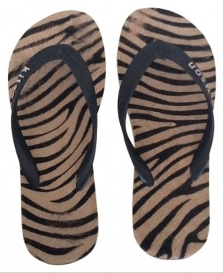 Preload https://item3.tradesy.com/images/kitson-tan-and-black-sandals-size-us-6-150287-0-0.jpg?width=440&height=440