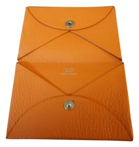 Herms calvi card cases up to 70 off at tradesy herms hermes calvi card case in chevre leather classic hermes orange color colourmoves