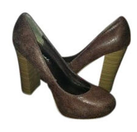 Preload https://item2.tradesy.com/images/wet-seal-chunky-brown-pumps-size-us-75-15036-0-0.jpg?width=440&height=440