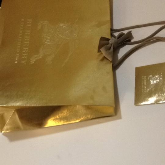 Preload https://item2.tradesy.com/images/burberry-gold-holiday-luxury-gift-bag-bow-ribbon-165x115x45-1503741-0-0.jpg?width=440&height=440