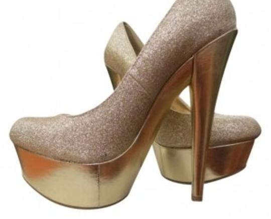 Preload https://img-static.tradesy.com/item/150412/anne-michelle-gold-pumps-size-us-6-0-0-540-540.jpg