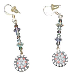 Whimsical drop earrings with a black, white and red circular pattern.