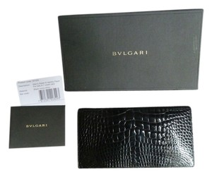 BVLGARI Bvlgari Elegant men's billfold wallet black shinny crocodile, made in Italy, brand new in original box. The perfect gift for the sophisticated gentleman.