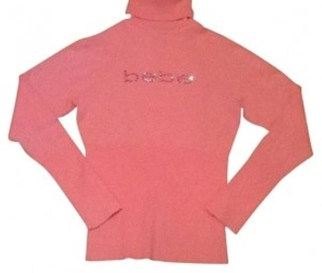 Preload https://item2.tradesy.com/images/bebe-baby-pink-is-the-brand-bling-sweaterpullover-size-12-l-150691-0-0.jpg?width=400&height=650