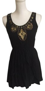 DuO Boutique short dress Black and gold on Tradesy