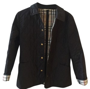 Burberry black qulited jacket with check linning inside, under collar and cuffs. Snap buttons sizeS. Made in England. Barley worn perfect condition. Black Jacket